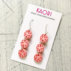 Polymer clay earrings, in red and pink