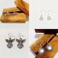 925 Sterling silver ear wire and Tibetan silver boho themed earrings.