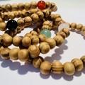 Wooden beaded bracelet with gemstones. Elasticised. Aromatherapy beads.