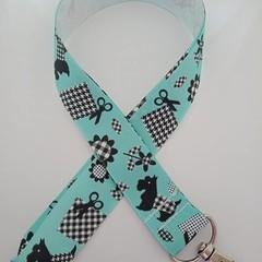 Green black and white dog patchwork print lanyard / ID holder / badge holder