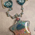 Sparkly blue whale necklace with heart beads