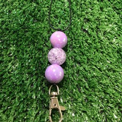 Purple bubblegum beaded lanyard.
