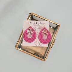 Pink polymer clay earrings with a gold flower charm