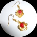 Pretty gold flowers with a red coral teardrop in the centre.