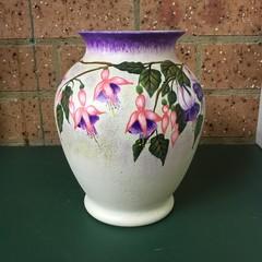Glass vase with Fuchsias.