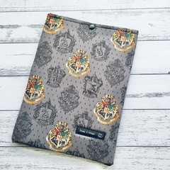 Popular wizard theme padded book sleeve. Booksleeve with closure.