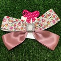 Unicorn and dusty pink bow with embellishments.