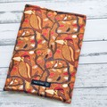 Indigenous bird art padded book sleeve. Booksleeve with closure.