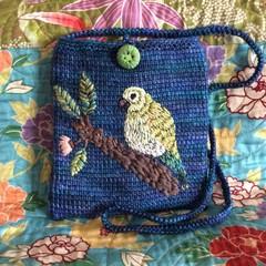 Blue Malabrigo yarn tunisian crocheted pouch