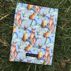 Kangaroo print padded book sleeve. Booksleeve with closure.
