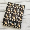 Padded kindle or e-reader sleeve. The Addams Family fun print.