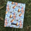 Kangaroo print padded book sleeve. Booksleeve with closure.
