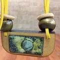 Asteroids - copper enamel pendant on wood