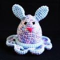 Bunny egg with cosy in shades of pink purple and blue