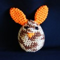 Bunny egg with cosy in shades of brown and orange