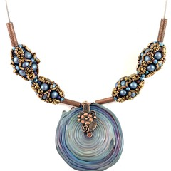Blue 'Swirling waters' necklace with hand beaded beads