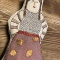 POCKET DOLL in burgundy culottes with polka dots.