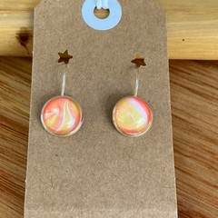 Unique hand painted earrings in a nickel free silver style setting