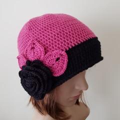 Women crochet pink and black beanie with crochet flower