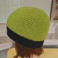 Women green and black wool beanie with crochet flowers