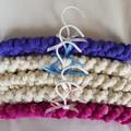 Hand knitted coat hanger