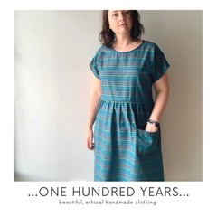 Vintage repurposed fabric dress, bottle green with rainbow stripes, only one.