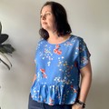 Blue vintage spring summer floral fabric women's top with ruffled hem, free size