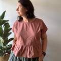 Dusty pink cotton top with ruffle hem