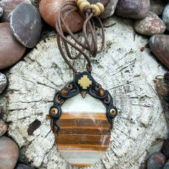 Beautifully set banded agate pendant on leather cord.