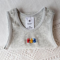Easter or baby shower. little singlets, hand embroidered rabbits ,