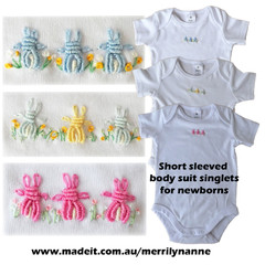 Easter or baby shower. short sleeved body suits, hand embroidered rabbits ,