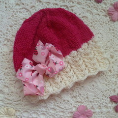 Baby girl's lacy beanie with large bow; fits 3 - 9 months;  5-ply wool
