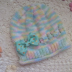 Baby girl's beanie w roll brim & hairclip bow; fits 6 - 12 months, acrylic