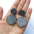Diagonal Stripe black and white Cross statement earrings