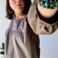 Khaki olive green cotton gathered sleeve smock top with scoop neck.