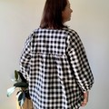 Black and white gingham check smock top with deep v neck and gathered sleeves