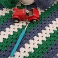 Blue, green and white crochet blanket