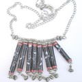 Necklace Fabric beads, black and red beads and Tibetan silver charms.