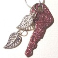 Upcycle Pendent necklace, recycled key, pink glitter and Tibetan silver leaves,