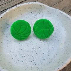 Green textured studs