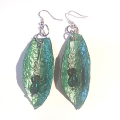 Handmade paper crafted into handmade earings in green with crystals.