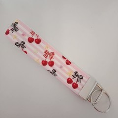 Pink cherry with bow key fob wristlet