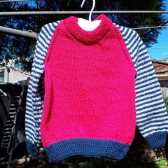 Red woolen jumper with striped sleeve