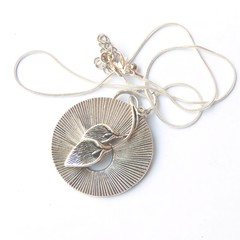 Art Deco pendant , silver with dual leafl charm and silver snake chain