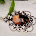 Bronze and Black Fluid Art Necklace with Glass Cabochon. Silver Plated. Filigree