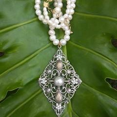 Romantic pearl choker with ornate Florentine pendant.