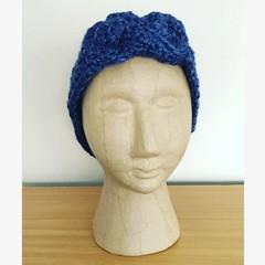 Knotted blue crocheted earwarmer headband