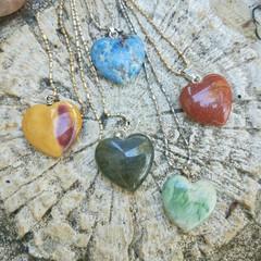 Simple yet striking gemstone heart necklaces..