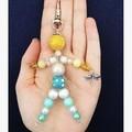 Beachy beaded person keyring with dragonfly charm