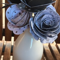 Small handcraall handcrafted paper flowers in a recycled  handleless jug